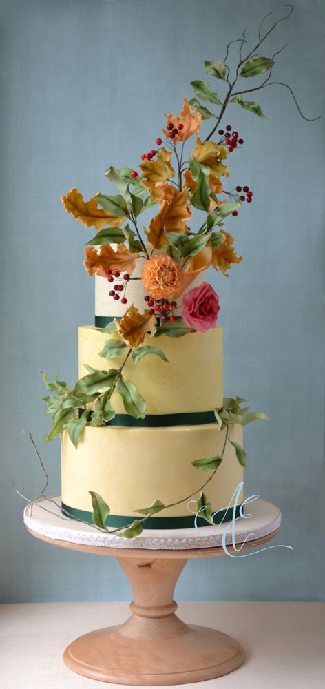 autumnal wedding cake on wooden stand