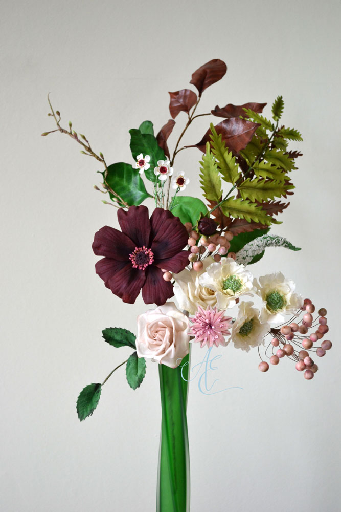 arrangement of sugar cosmos roses scabious astrantia waxflowers berries and foliage