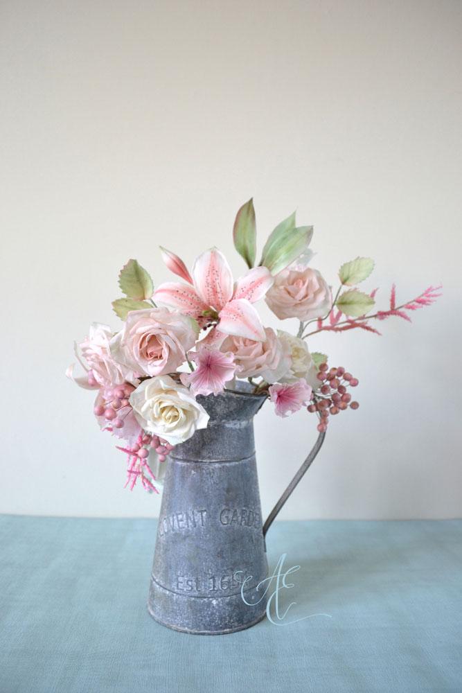 pastel pink sugar lily, rose, cherry blossom, astilbe, snowberry arrangement