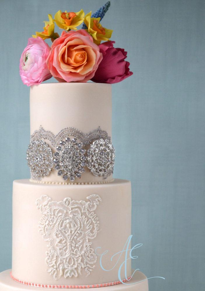 Wedding cake close-up diamante detail and vibrant sugar flowers