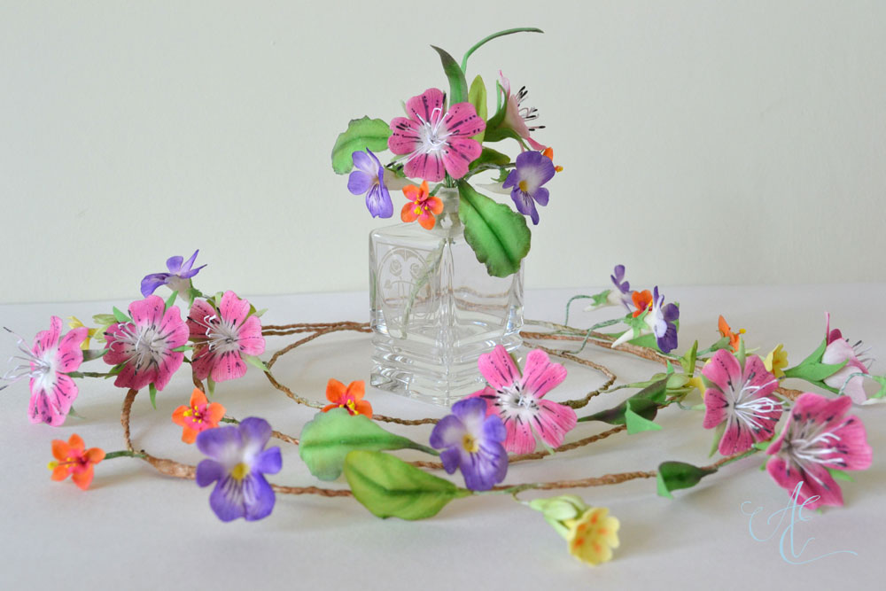 Bright pink purple and yellow sugar wild flowers garlands