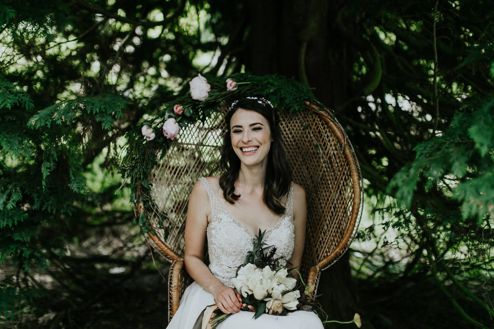 bride portrait seated on chair in woodland