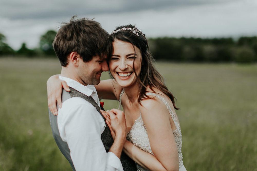 groom smiling bride grinning