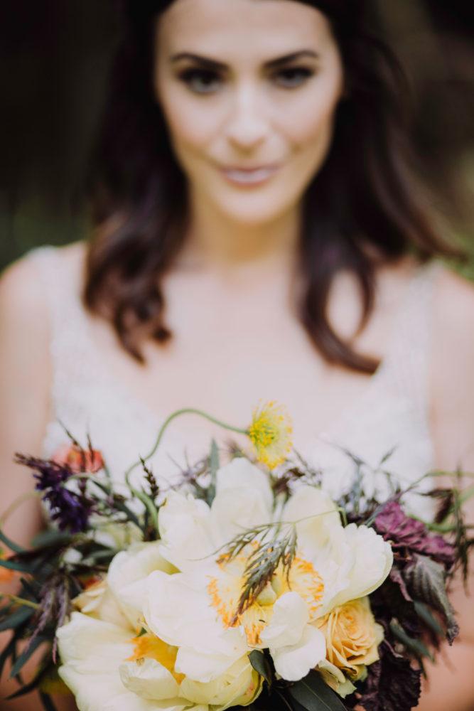 bride holding floral bouquet