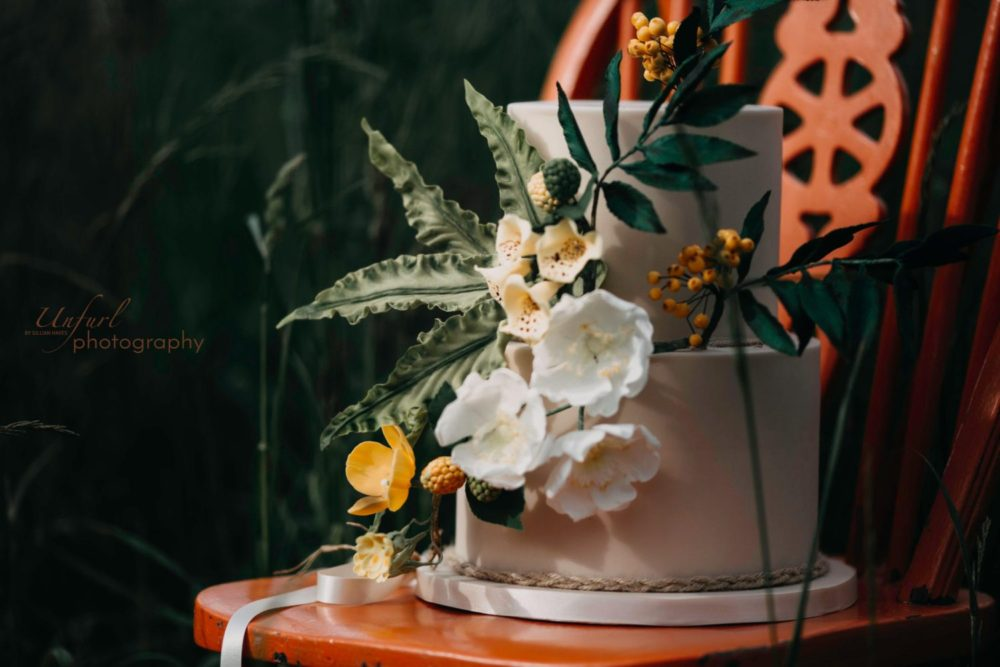 wedding cake with woodland sugar flowers