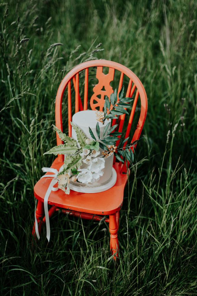 woodland wedding cake in field