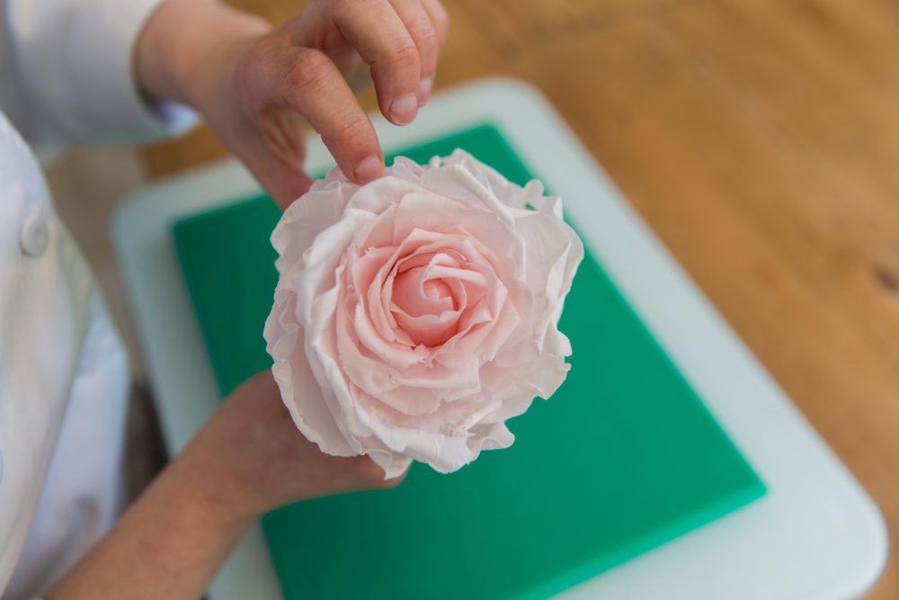 arranging sugar rose petals