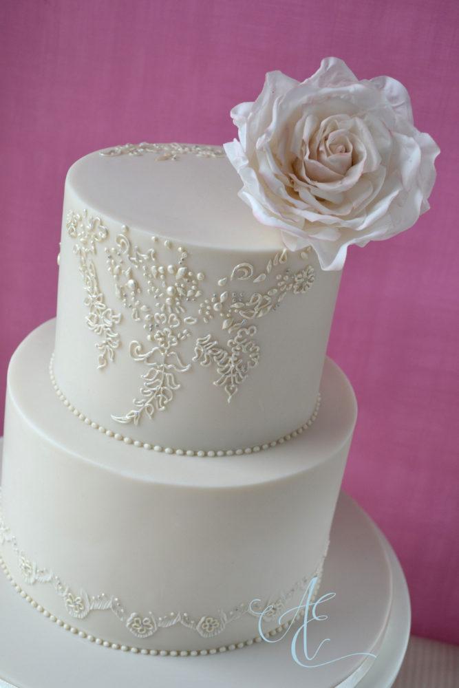 ivory wedding cake with sugar rose