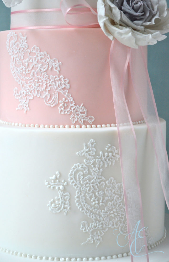 pink and white floral lace wedding cake