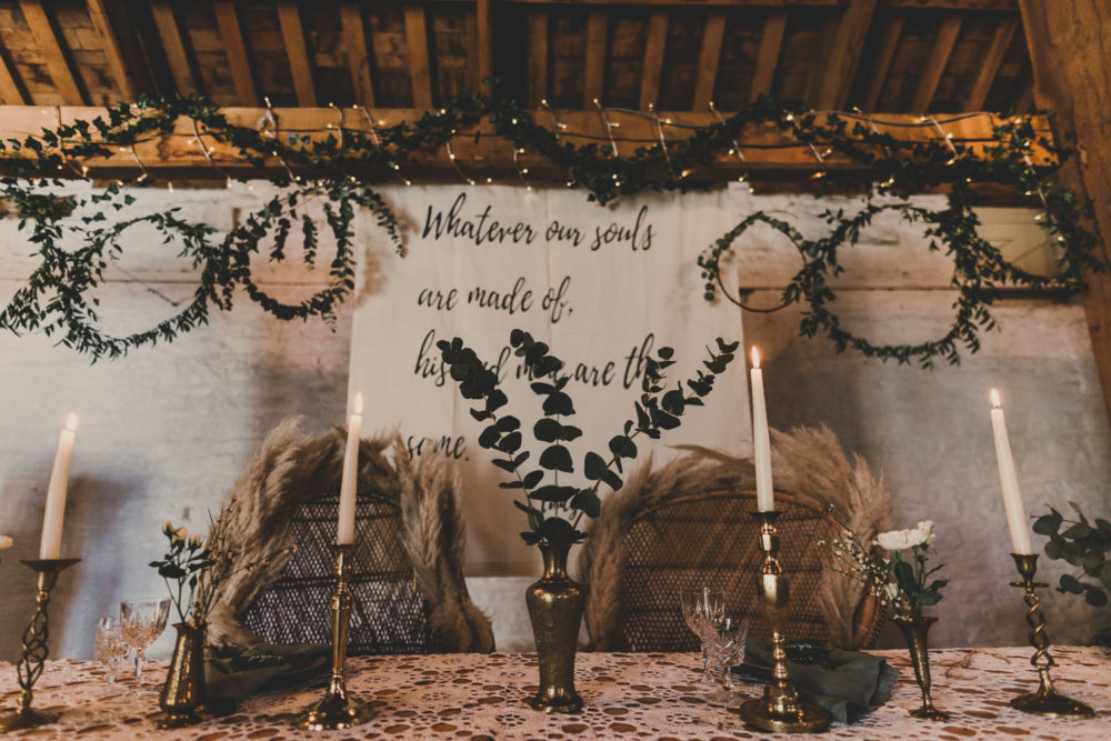 bohemian wedding top table brass tableware and foliage wreath styling