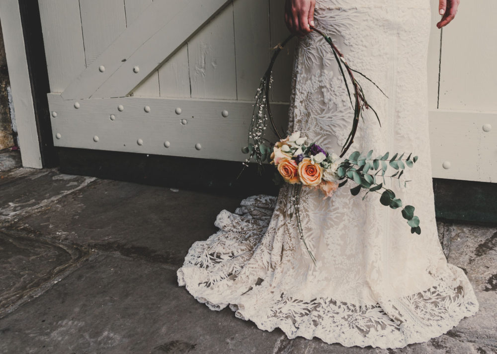 lace wedding dress and floral hoop close up