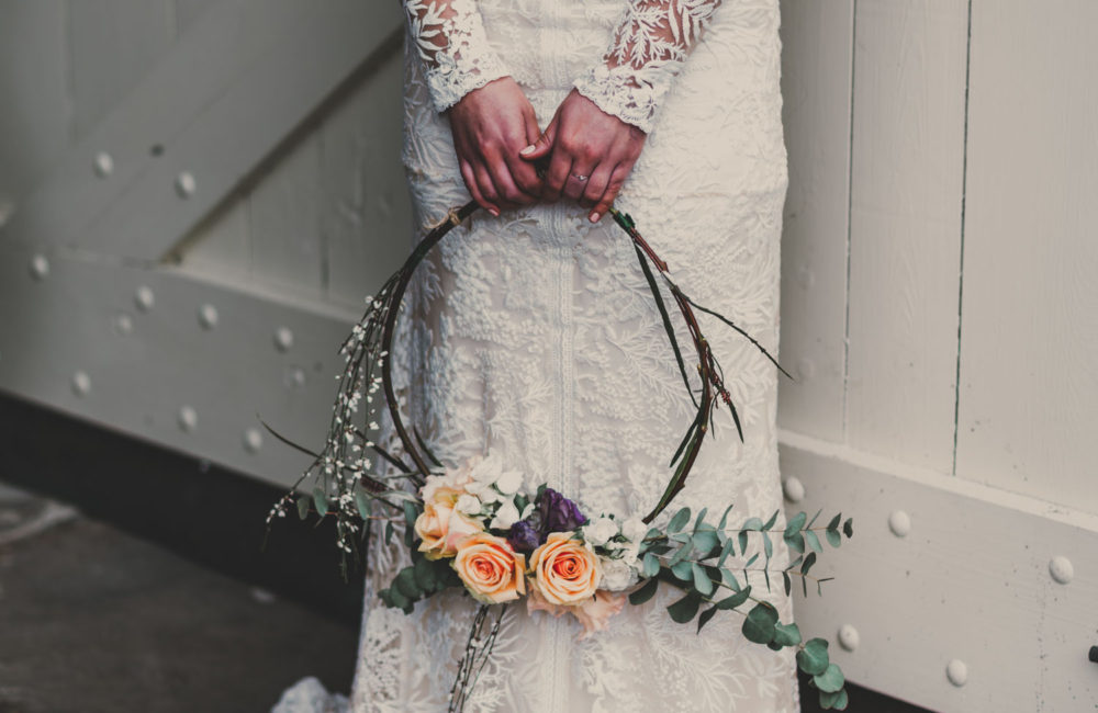 bride holds floral hoop close up