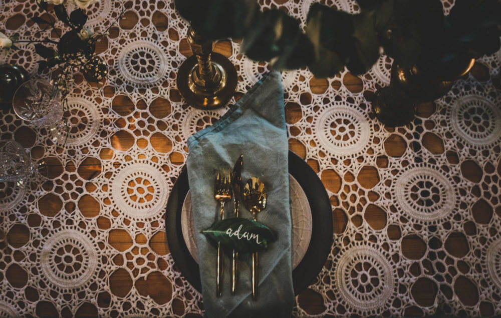 bohemian brass and foliage table setting