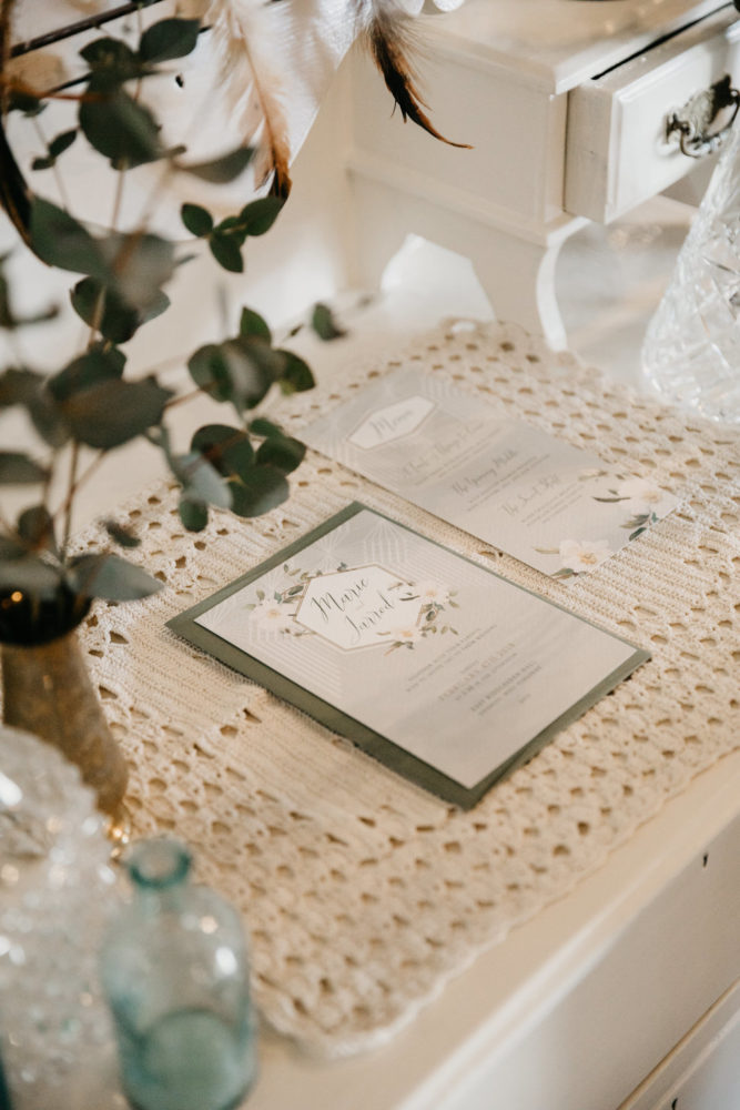 Menu on macrame tablecloth with glassware