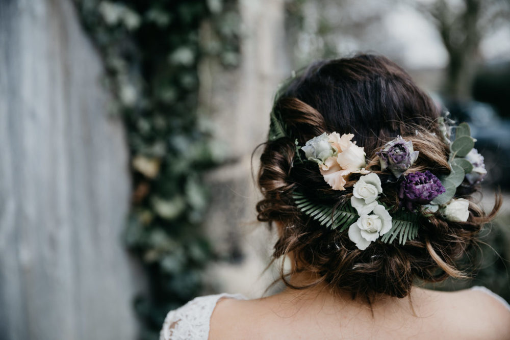 brides hair dressed with flowers and ferns