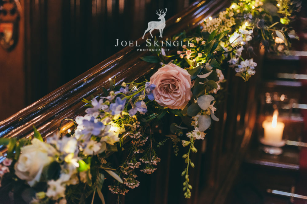 Close up staircase wedding flowers by Twisted Willow Floristry