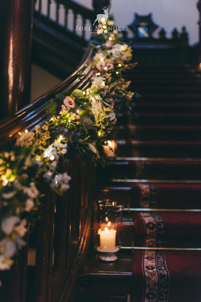 Floral staircase styling by Twisted Willow Floristry