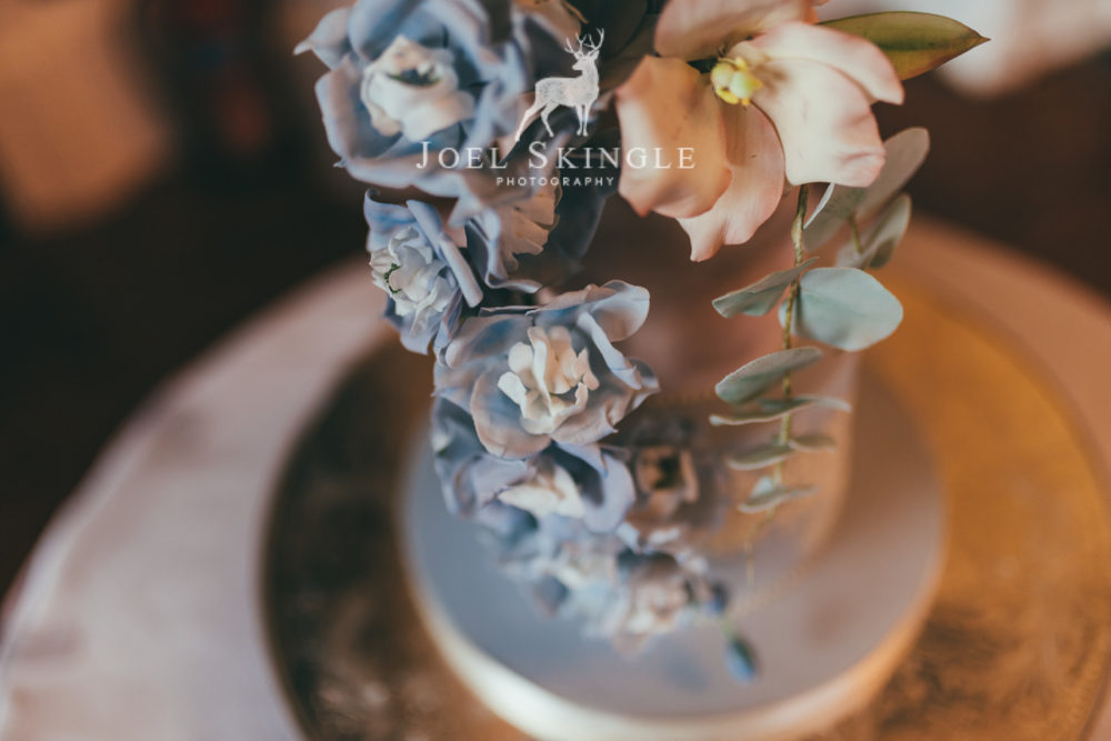 blush and blue wedding cake close up