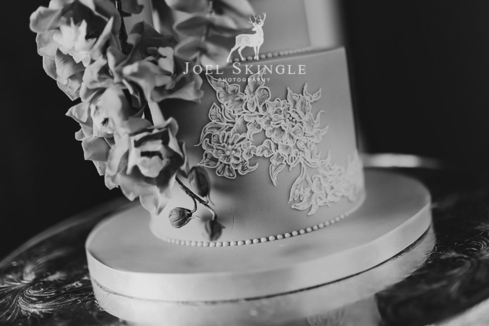Close up hand piped lace wedding cake black and white image