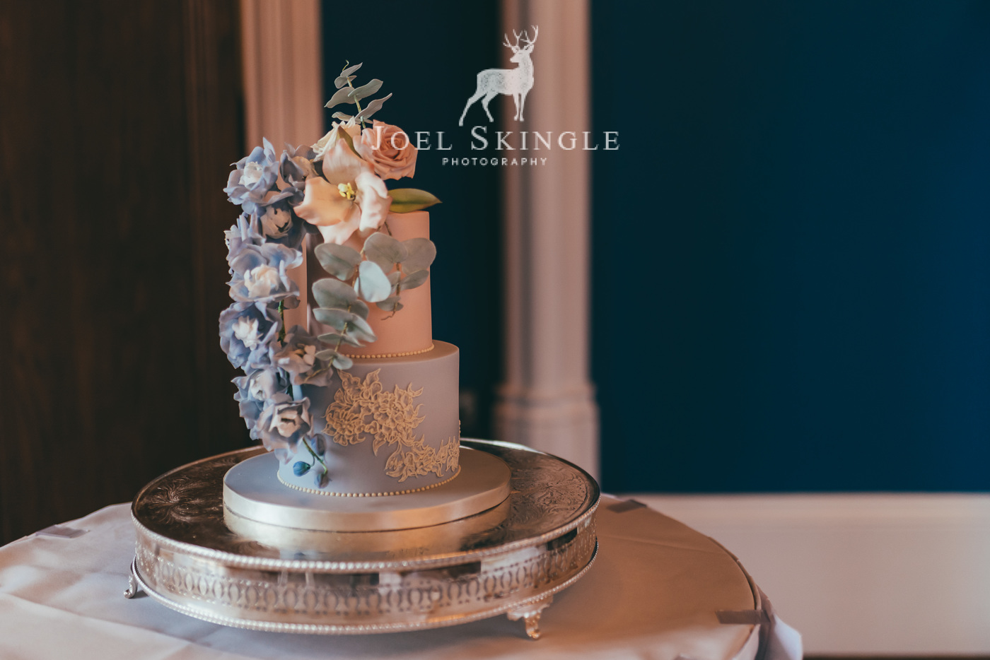 blush pink and dusty blue wedding cake with sugar flowers and foliage