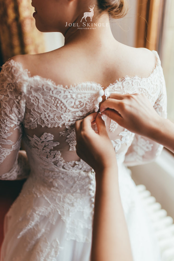 Buttoning wedding dress close up