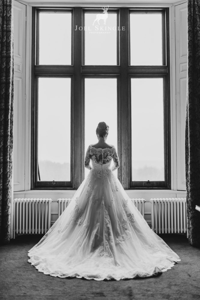 Bride in wedding dress captured from behind