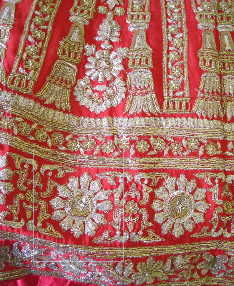 gold and red wedding dress skirt