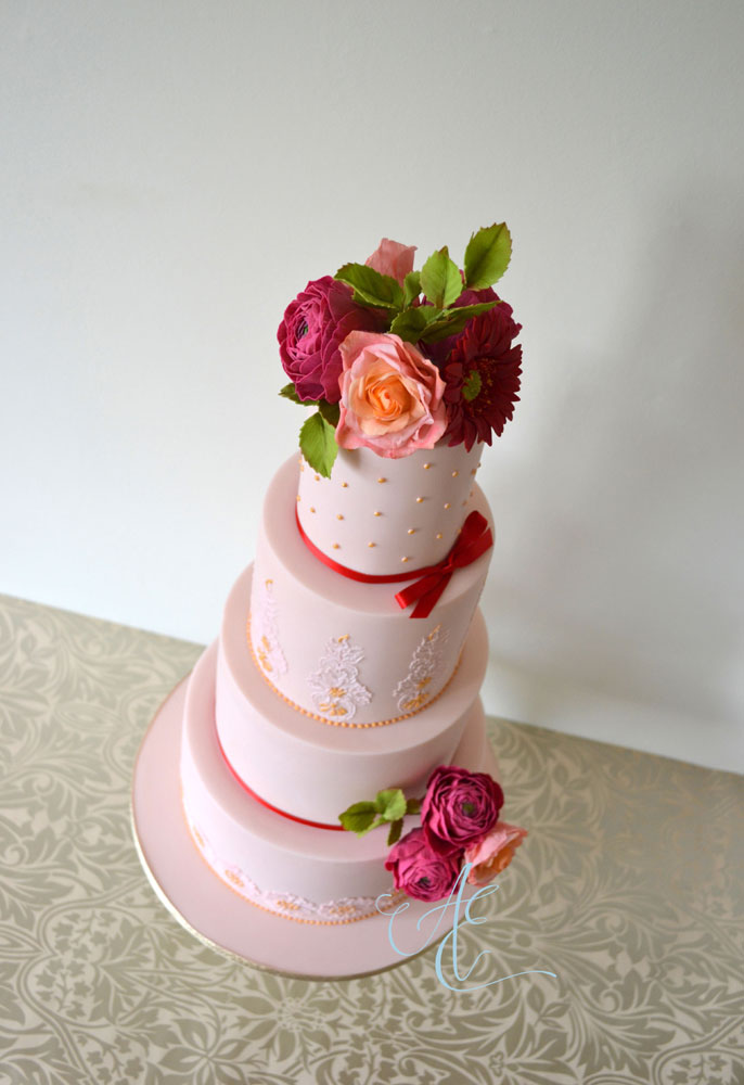 wedding cake with vibrant sugar flowers aerial shot