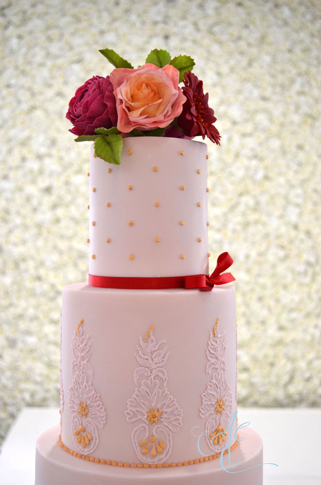 vibrant wedding cake top two tiers