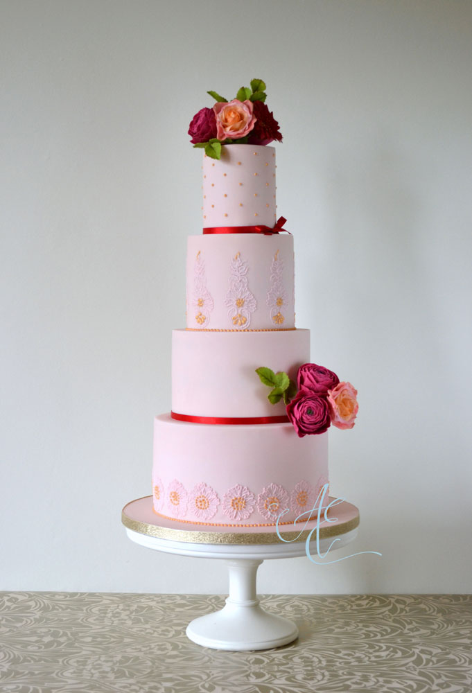 wedding cake with vibrant sugar flowers