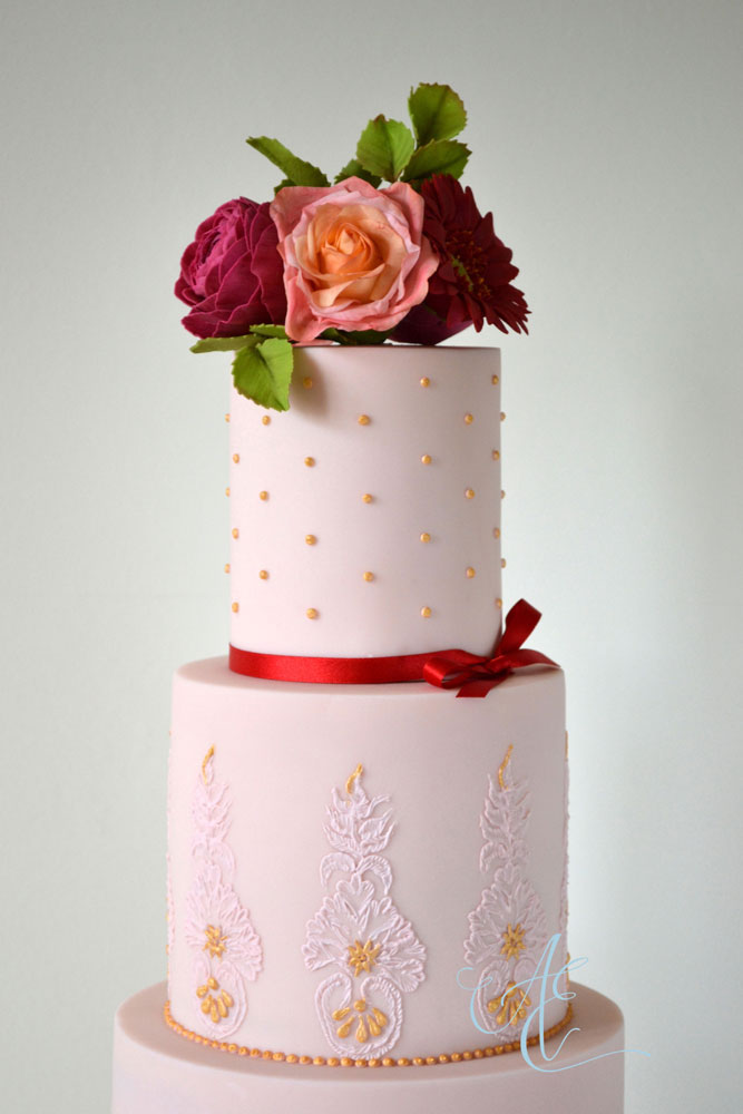 close up vibrant wedding cake top two tiers