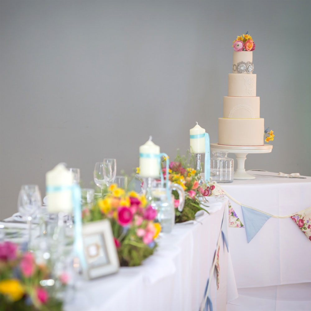 vibrant wedding cake and top table