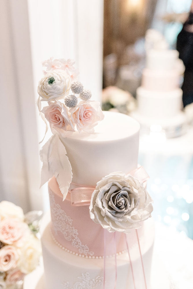 Georgina Brewster Photography Blush pink wedding cake with sugar flowers and lace