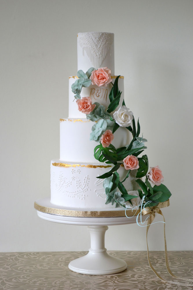 bohemian style wedding cake with sugar floral wreaths