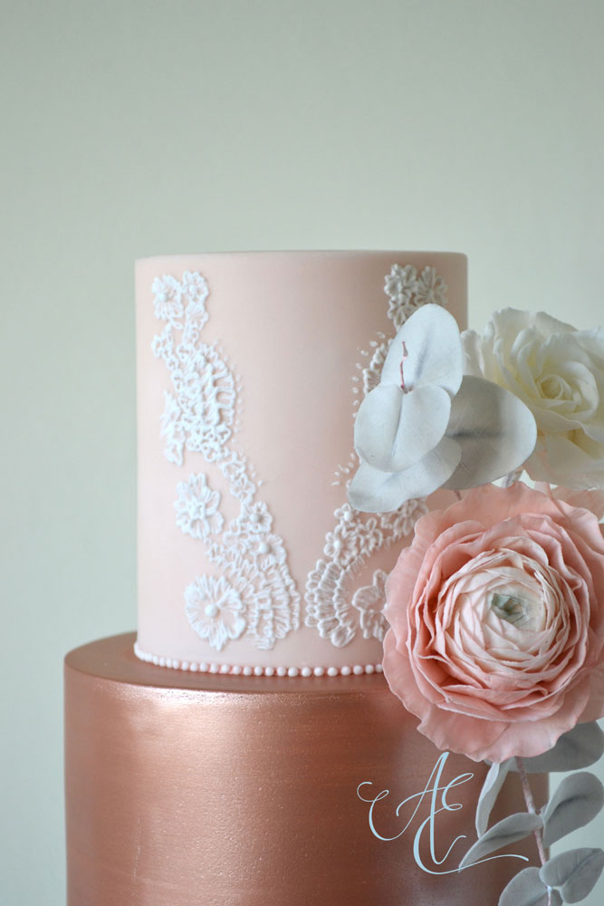 blush rose gold and marble wedding cake close up