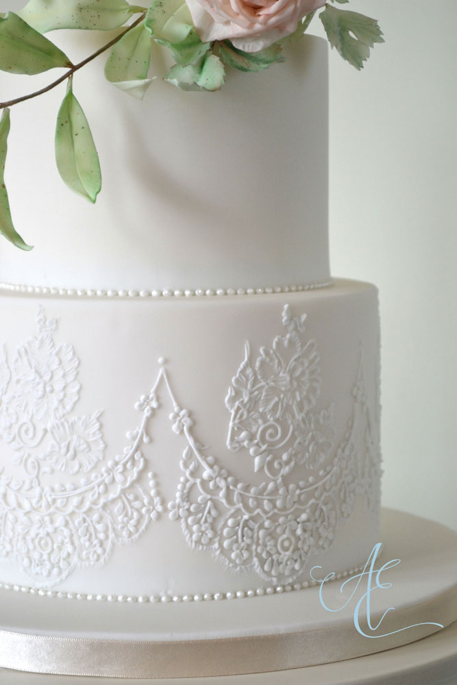 close up lace piped wedding cake
