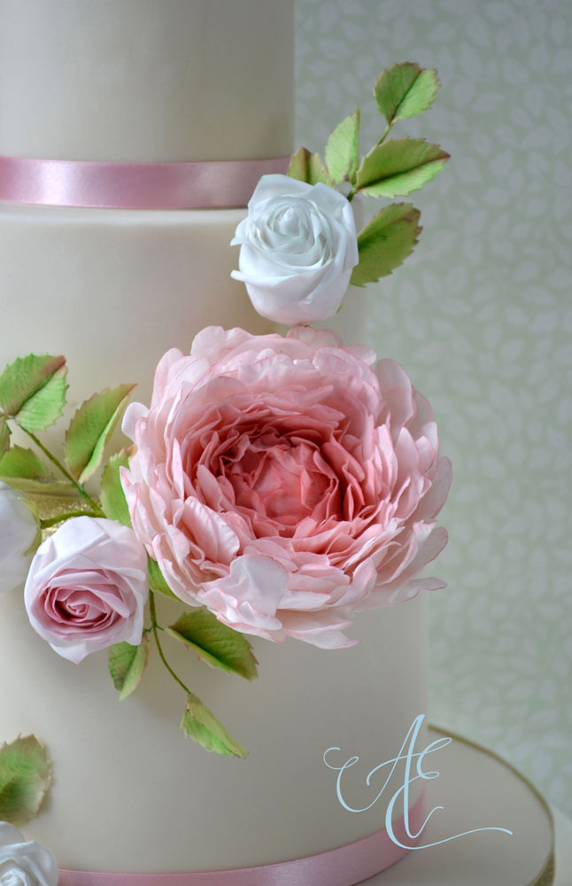 close up sugar peony and rosebud wedding cake