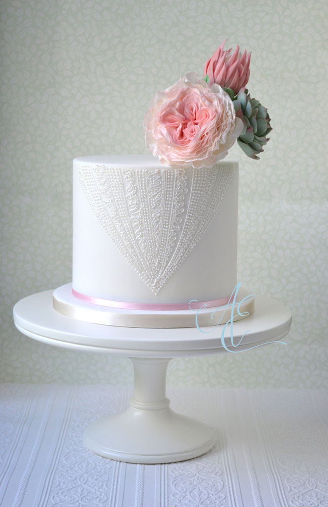 Elegant piped wedding cake with statement sugar flowers