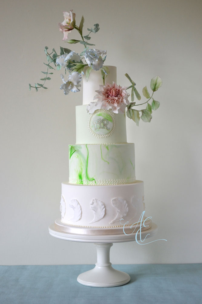 art nouveau wedding cake with stylised sugar floral arangement