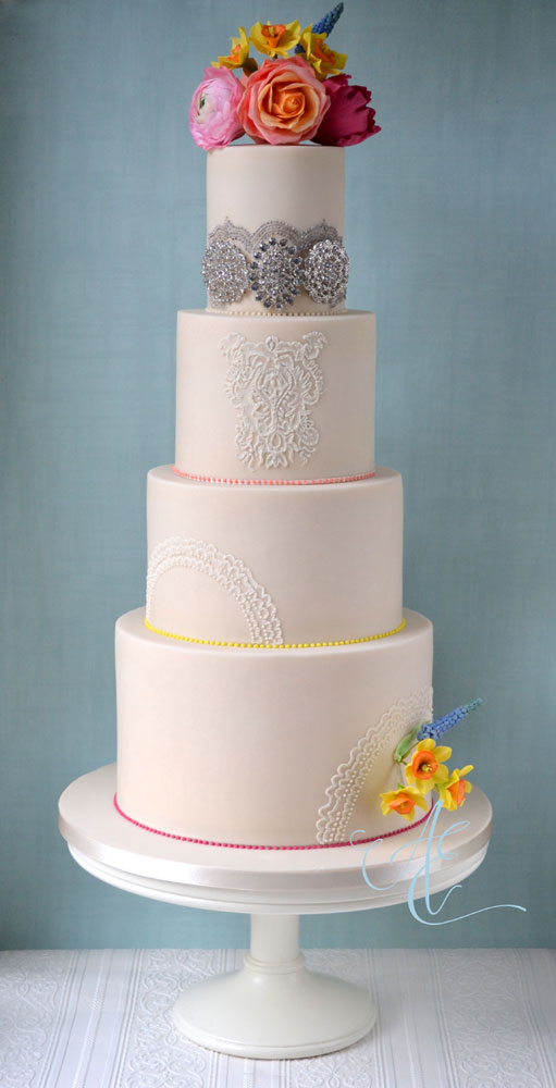 Elegant wedding cake with vibrant sugar flowers
