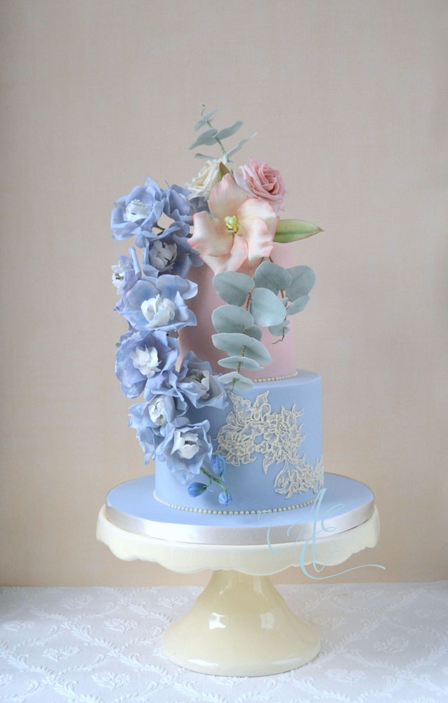 blush and dusty blue wedding cake with matching sugar flowers