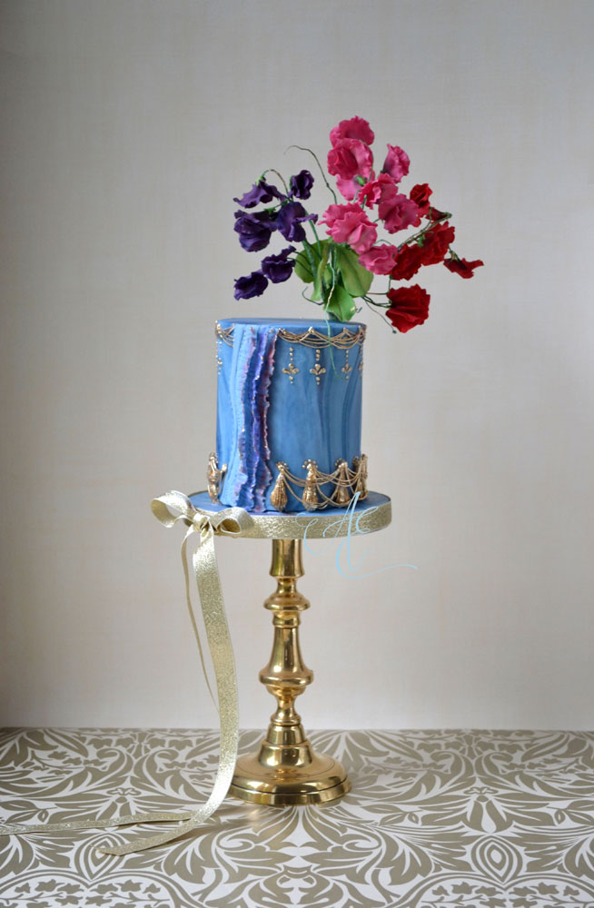 marbled blue and gold cake with sugar sweet peas
