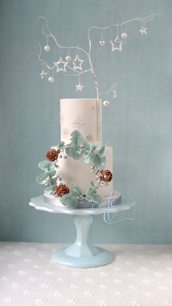 wintry white wedding cake with sugar wreath