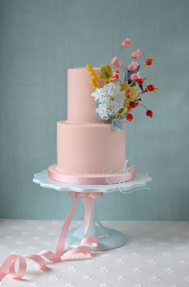 Blush pink christening cake with sugar starflowers,poppy seed heads and rosehips