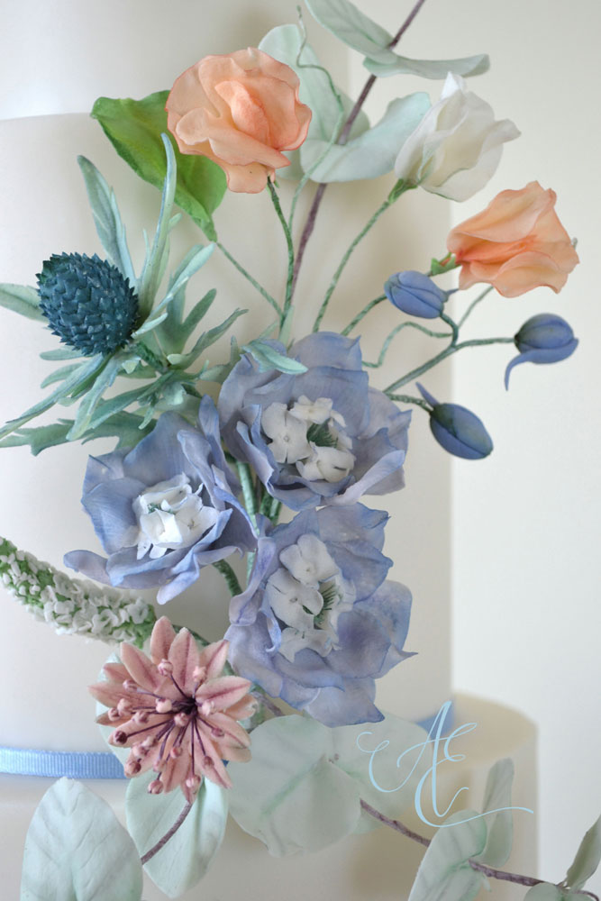 close up sugar delphiniums sweet peas astrantia and sea holly