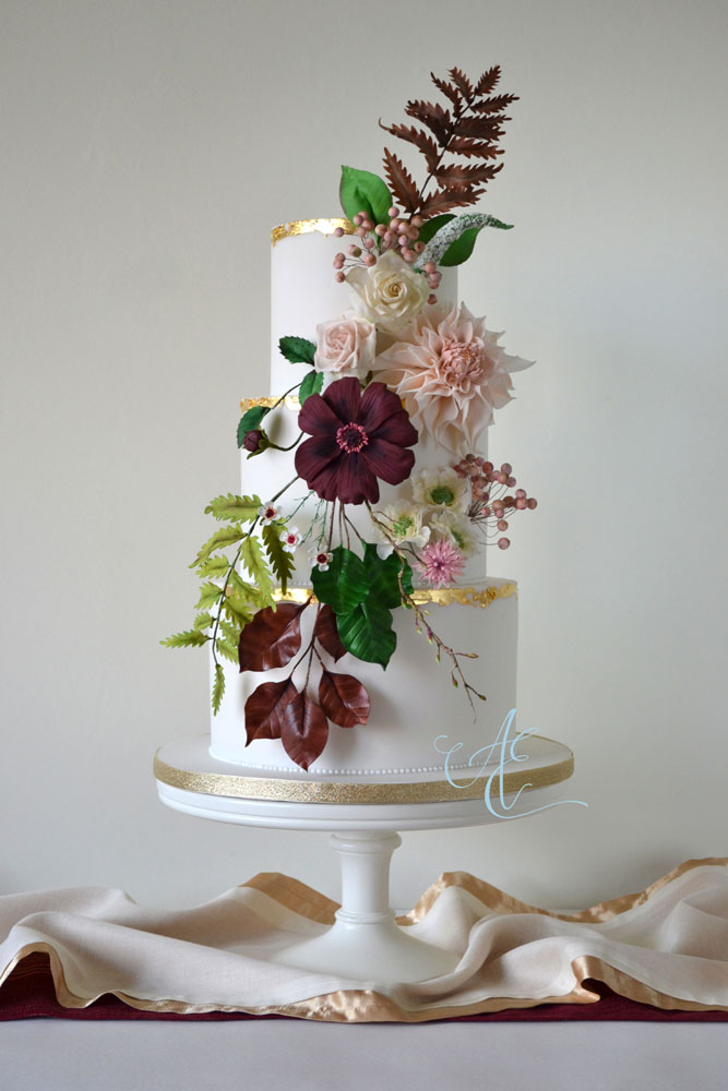 Wedding cake with autumnal sugar flowers and foliage in nude and earthy tones