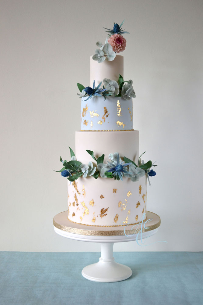 foliage and sea  holly garlands wedding cake