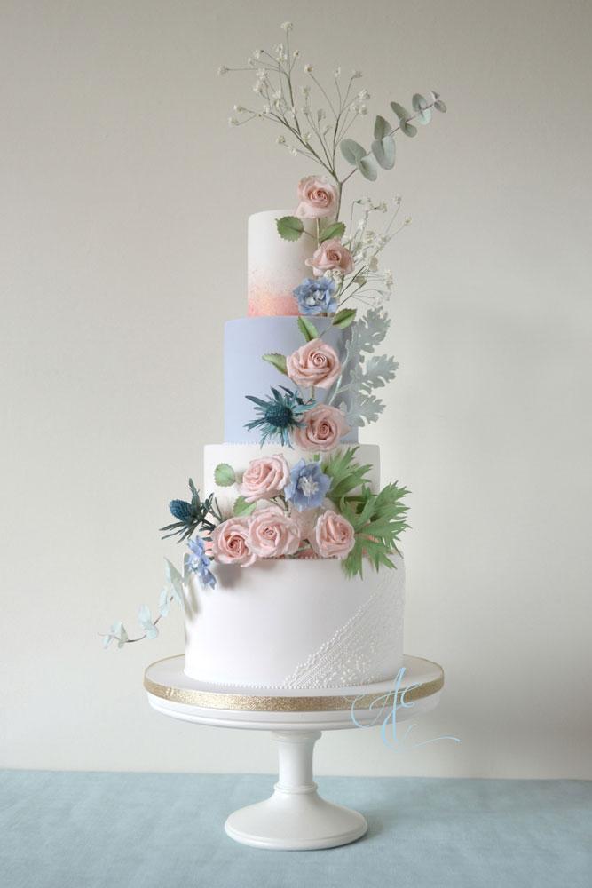 blush and blue floral cascade wedding cake tithe barn wedding