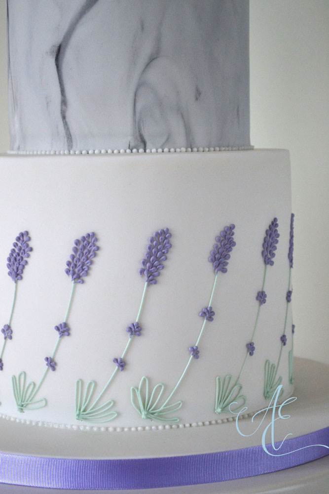 weddig cake with hand piped lavender close up