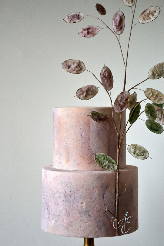 close up plaster inspired textured wedding cake